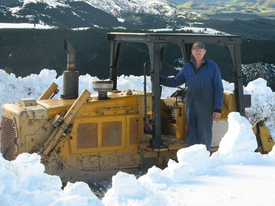 John Fissenden clearing snow from road